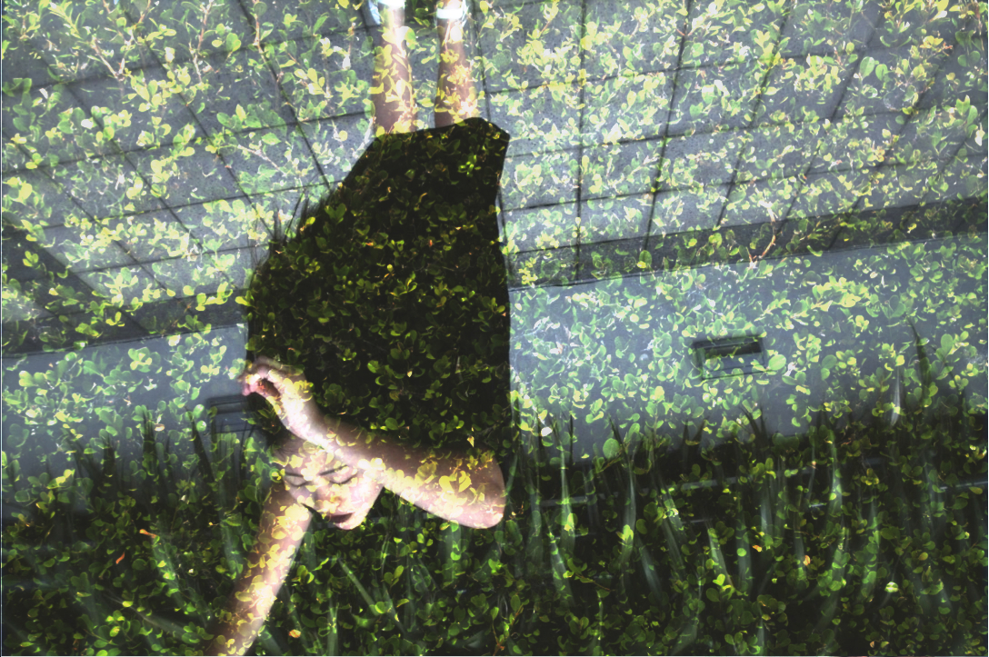 Anthea épique tilting backwards in double exposure shot with green leaves