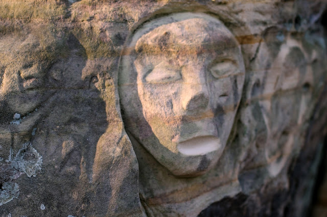 carved graffiti in the sandstone walls of a bluff in Mill Bluff State Park, WI