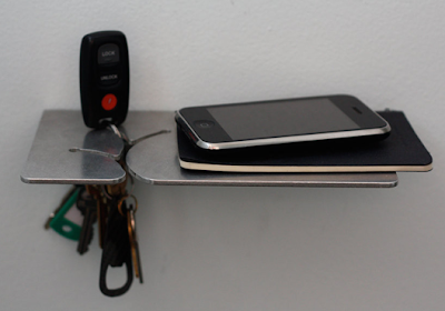 small shelf to hold keys, smartphone, etc.