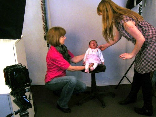 Passport Photo Shoot: Propping up the baby