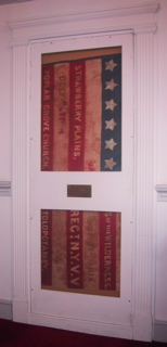 After support and stabilization of large historic flag, museum display, small space