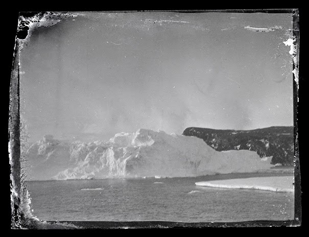 Iceberg and land, Ross Island. - 100-Year-Old Box Of Negatives Discovered Frozen In Block Of Antarctica's Ice