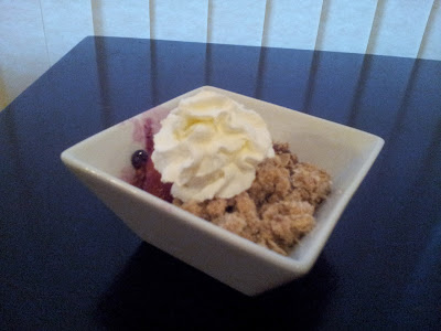 Peach blueberry crisp with whipped cream