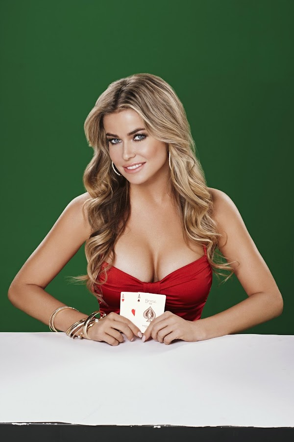 Carmen Electra in a sexy red dress and a great pair of ases in her hand