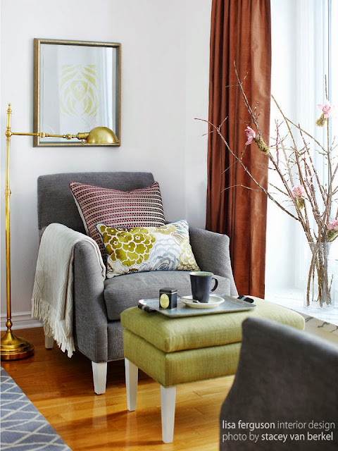 a cozy sofa and ottoman for a great reading experience shone by abundant light and beautiful pieces