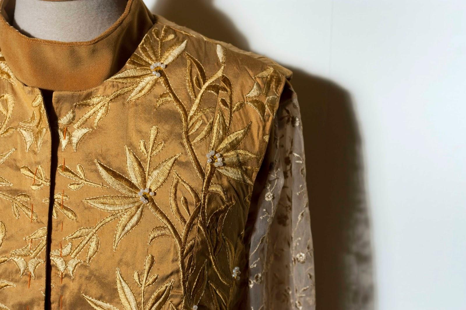 golden vest embellished with pearls