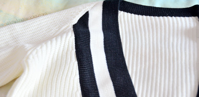 SheInside sells the popular white-and-black preppy V-neck sweaters, a rising trend among fashion bloggers.