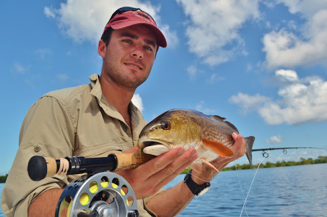 Montana angler with a healthy Redfish on Fly in the Pine Island Sound