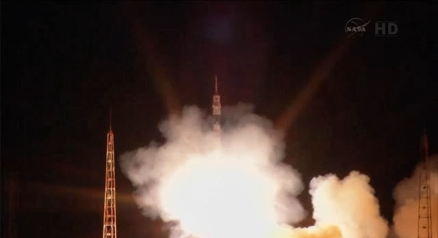 Soyuz Commander Oleg Kotov and Flight Engineers Mike Hopkins and Sergey Ryazanskiy launched aboard a Soyuz TMA-10M spacecraft at 4:58 p.m. EDT Wednesday. Image Credit: NASA TV