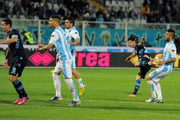Napoli player Blerim Džemaili shoots to score from long range against Pescara