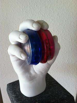 hand sculpture holding yo-yo