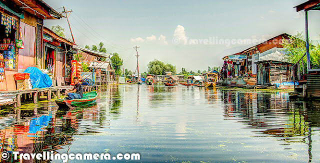 Dal Lake is one of the most popular lakes of India, which is located in Srinagar, the summer capital of Jammu and Kashmir. The urban lake, which is the second largest in the state, is integral to tourism and recreation in Kashmir and is nicknamed the 'Jewel in the crown of Kashmir' or 'Srinagar's Jewel'. The lake is also an important source for commercial operations in fishing and water plant harvesting.The shore line of the lake is encompassed by a boulevard lined with Mughal era gardens, parks, houseboats and hotels. Scenic views of the lake can be witnessed from the shore line Mughal gardens, such as Shalimar Bagh and Nishat Bagh built during the reign of Mughal Emperor Jahangir) and from houseboats cruising along the lake in the colourful shikaras. Dal Lake has some Floating gardens as well. The floating gardens, known as 'Rad' in Kashmiri, blossom with lotus flowers during July and August. The wetland is divided by causeways into four basins - Gagribal, Lokut Dal, Bod Dal and Nagin (although Nagin is also considered as an independent lake). During our trip to Shrinagar, we stayed in a hotel around Nagin lake only. Oldest Five star of the city is located on the bank of Nagin Lake. Lokut-dal and Bod-dal each have an island in the centre, known as Rup Lank (or Char Chinari) and Sona Lank respectively.  There are some personal houses around Dal Lake and people have their own boats to travel from one place to another for getting stuff from Lake-Market, which is again located inside Dal Lake only. Houseboats and the Dal Lake are widely associated with Srinigar and are nicknamed 'floating palaces', built according to British customs.The houseboats are generally made from local cedar-wood and are graded in a similar fashion to hotels according to level of comfort.Many of them have lavishly furnished rooms, with verandas and a terrace to serve as a sun-deck or to serve evening cocktails.They are mainly moored along the western periphery of the lake, close to the lakesid