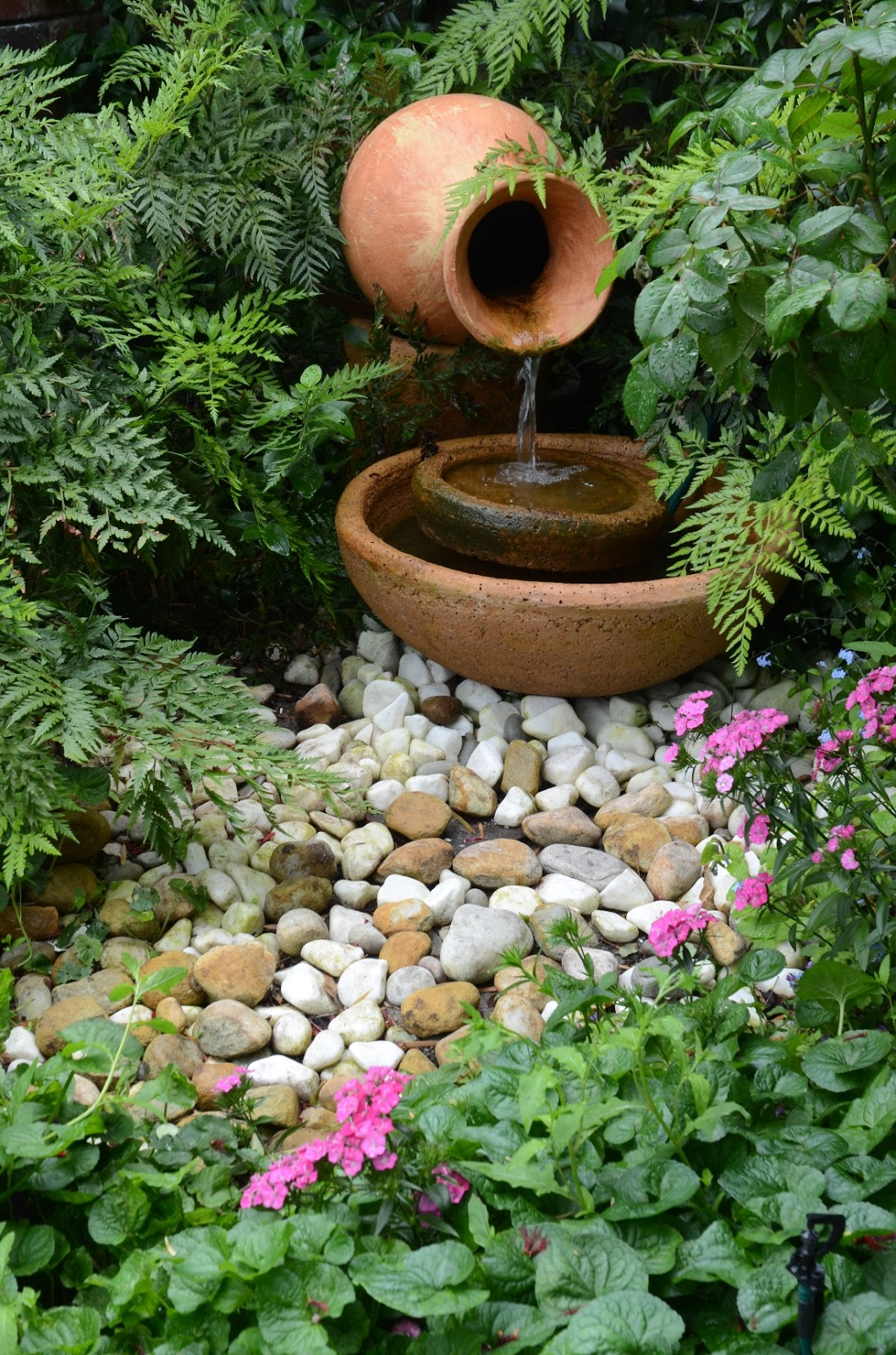 66 square feet plus cape town open gardens for Backyard water fountains