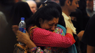 Two women hug each other at Karachi Airport