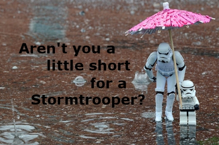 Father and son stormtroopers in the rain.