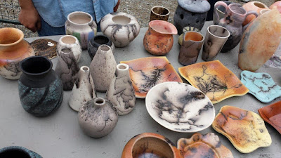 Finished pottery pieces from a raku firing - horsehair raku, naked raku, saggar raku.