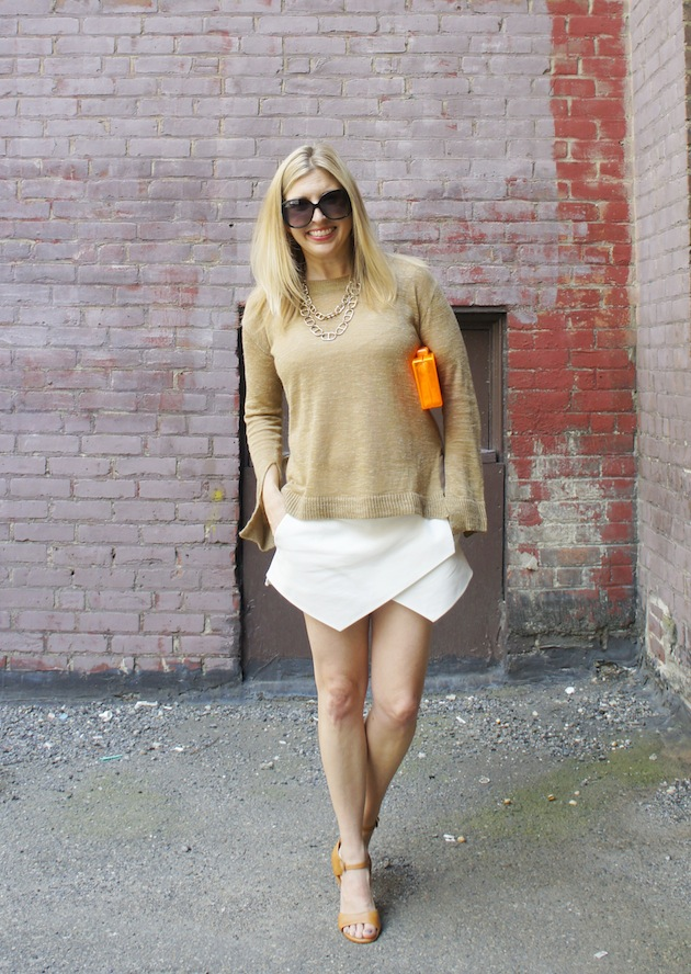 gold sweater, zara skort, orange lucite clutch