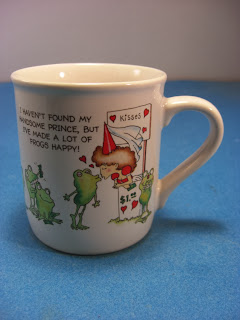 http://www.bargaincart.ecrater.com/p/18961168/hallmark-mug-have-to-kiss-frogs#