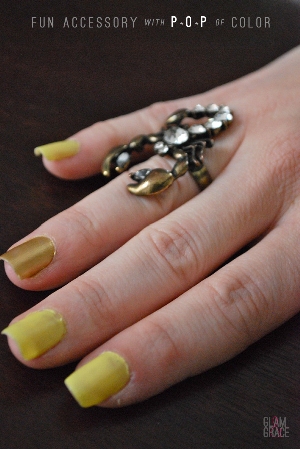 yellow nails and gold ring