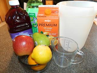 Sangria ingredients- cranberry-grape juice, orange juice, lemon juice, pear, apple, and orange