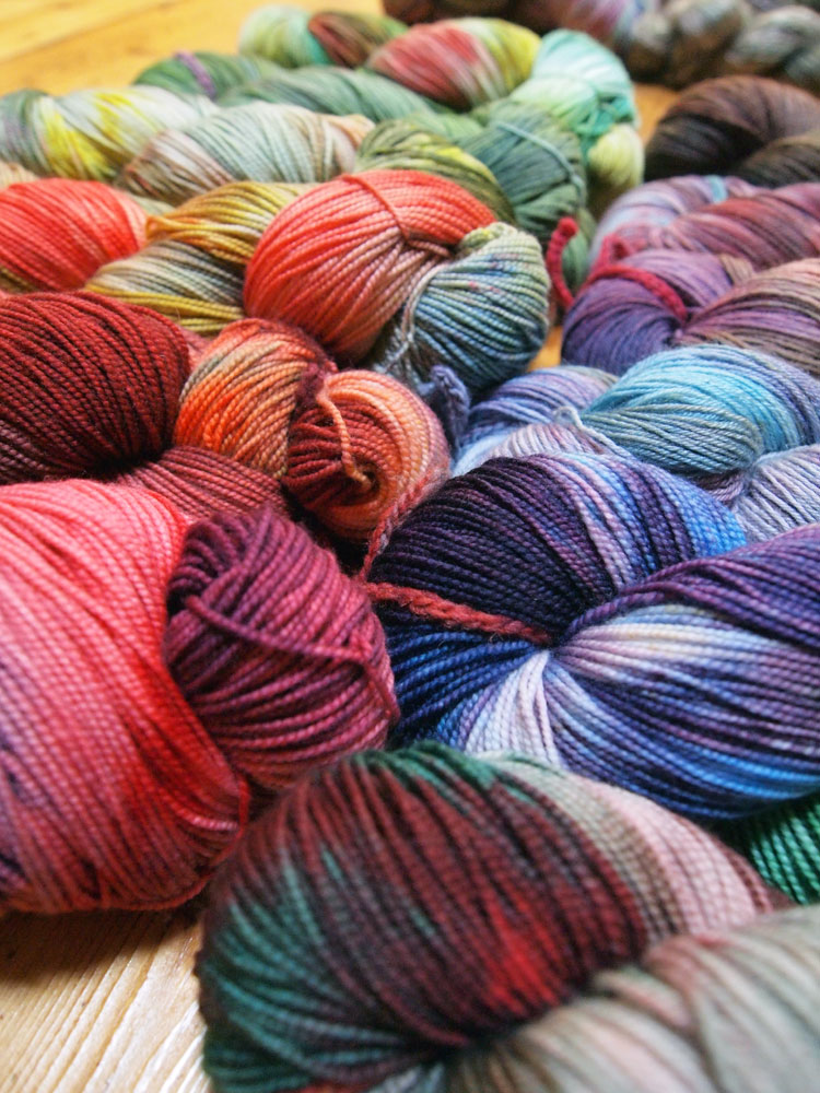 by Megan features hand-dyed sock yarns and handspun yarn from wool ...