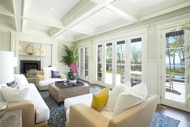 Living room Sag Harbor home French doors coffered ceiling fireplace wicker furniture