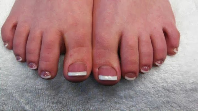 full acrylic french white toe extensions with double gel topcoat nail art design