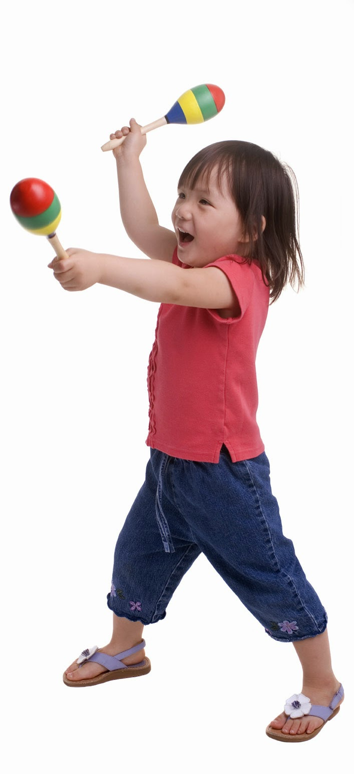 Young girl dancing with maracas