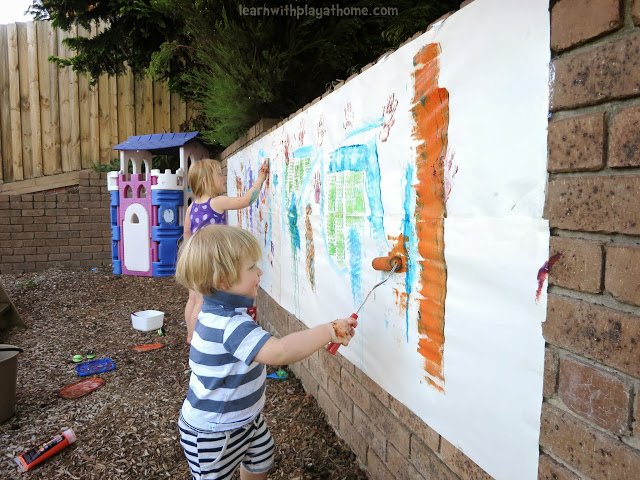 Learn with play at home an invitation to paint big for Best paint for outdoor crafts