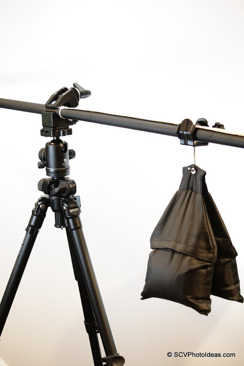 Sand sack on backdrop tube assembly