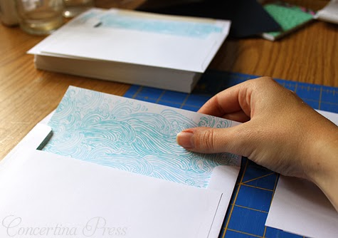 Lining wedding invitation envelopes with waves pattern - Concertina Press