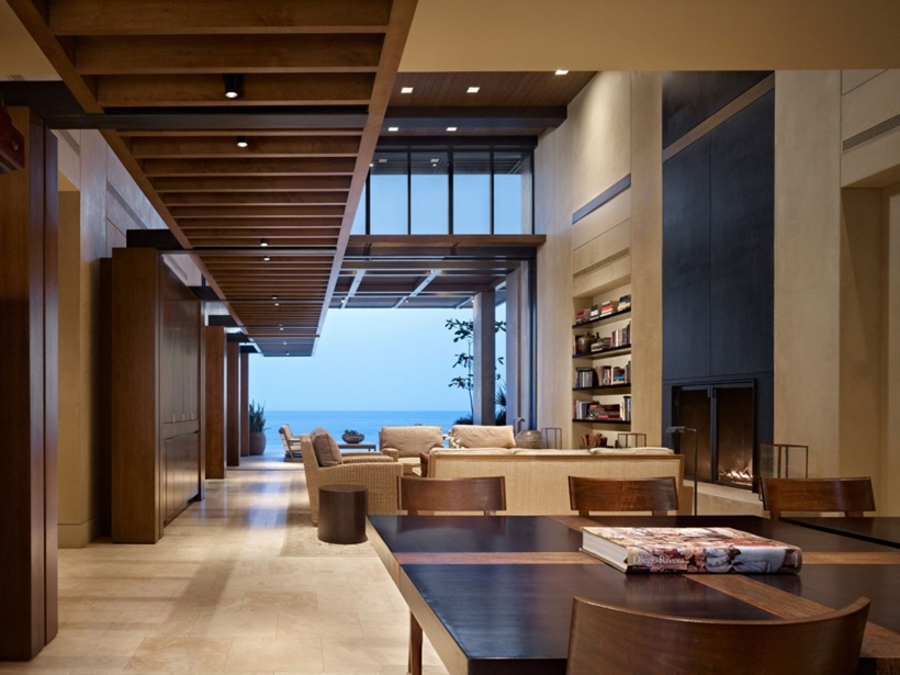 Dining room to living room in the Gorgeous modern stone house on the beach