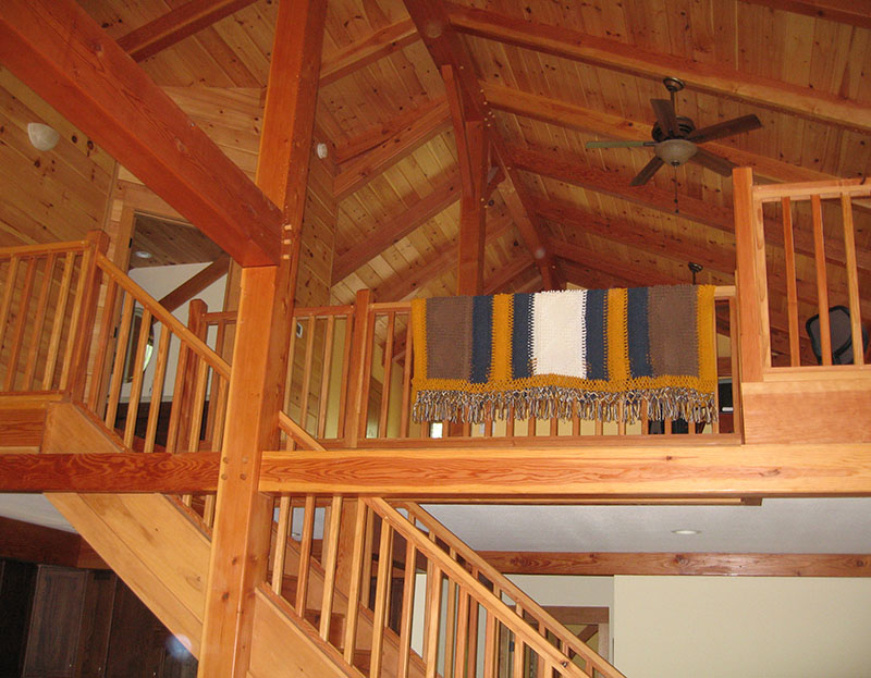 view of the interior timber framing and loft space.
