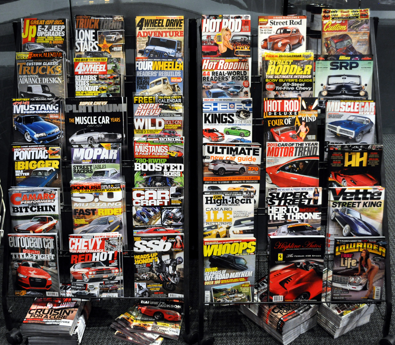 Just a car guy the magazine rack in the petersen museum for Trendy magazine rack