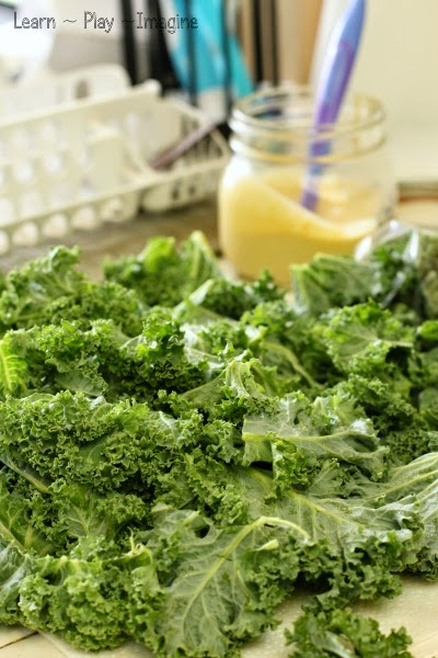 The best recipe for homemade kale chips - a mother approved and kid tested recipe.