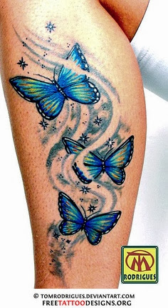 Tribal butterfly tattoo on leg