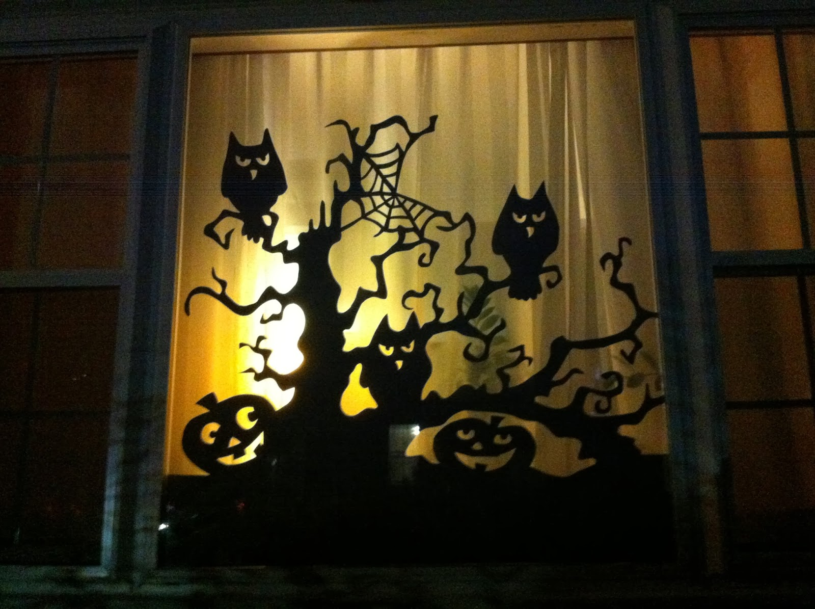 Creatively lori it 39 s beginning to look a lot like for Halloween window designs