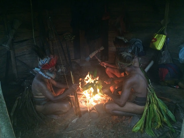 Witchdoctor around a fire - Papua New Guinea