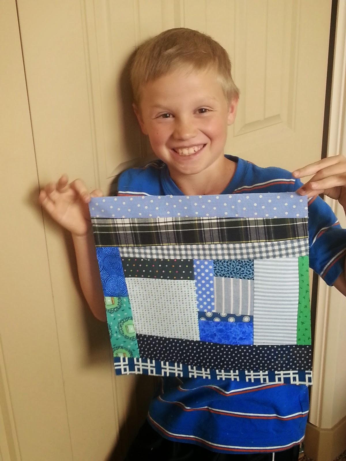 A boy and an Improv Quilt Block