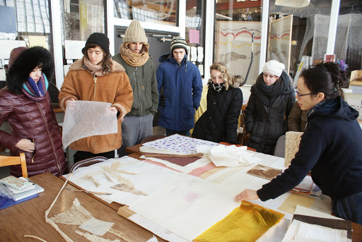 A group of students look at paper