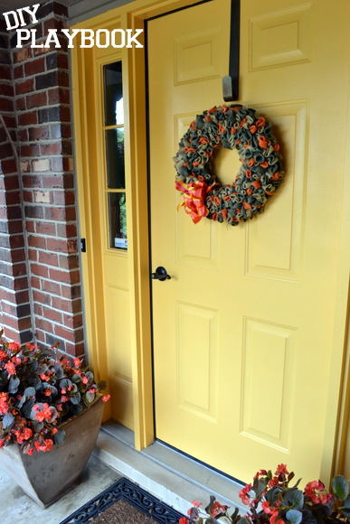 This bright yellow yellow front door really catches people's eyes! It looks great decorated with these wreaths.