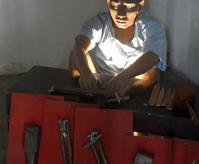 nail-hammering-tool-corrections-museum-bangkok-thailand.JPG