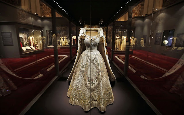 The Queen's Coronation has been brought to life by a major new exhibition showcasing the ceremony's fabulous dresses and artefacts - and private home movies. The dazzling coronation dress the Queen wore for the ceremony is the centrepiece of the exhibition marking the historic event's 60th anniversary.