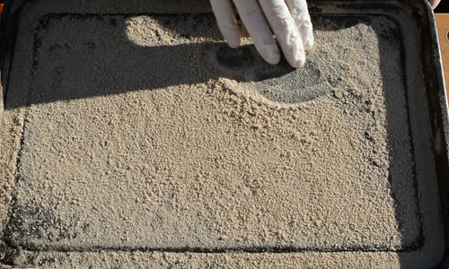 Break up the sand if stuck