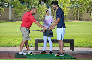 A golf instructor in a teaching session.