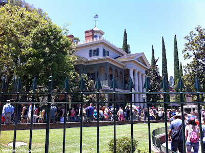 Haunted Mansion Disneyland exterior queue lawn house ride