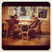 Men Sat at a Table Cafe in Istanbul