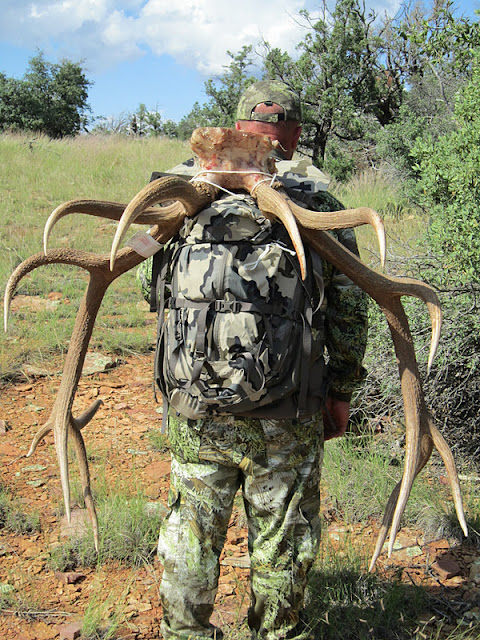 Todd Brooks Arizona Archery Elk Picture with Colburn and Scott Outfitters, packing his bull out