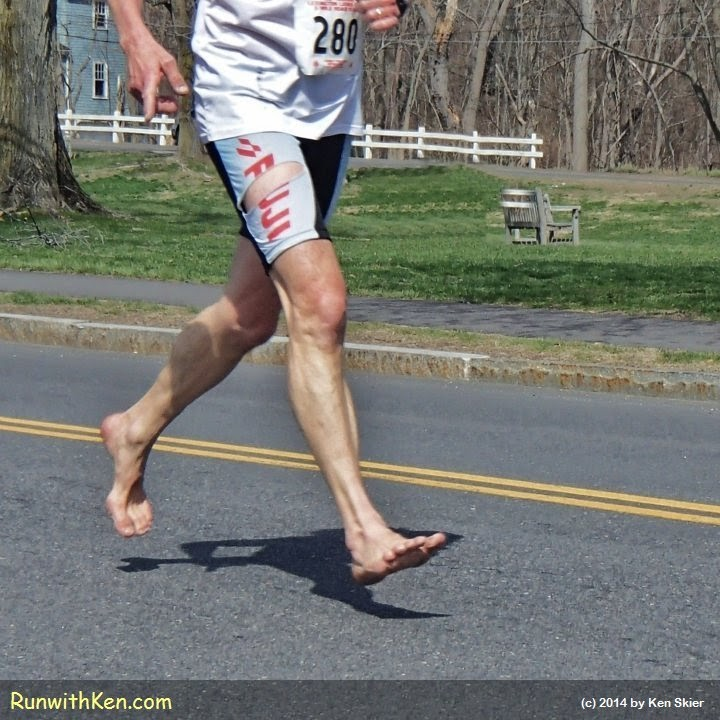 Barefoot runner--running barefoot at the 100th Patriots Day 5-mile Road Race in historic Lexington, MA