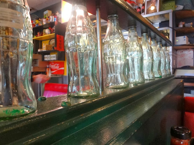 Vintage Coke bottle railing, inside Sophie's Cosmic Cafe, Vancouver